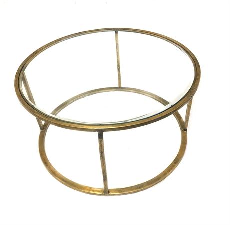 Produktbild, soffbord med glasskiva och guldram.